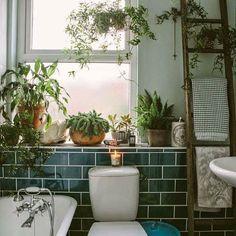 Gorgeous bathroom. love all the plants