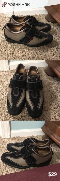 Tod's black suede 6.5 fashion shoes Tod's shoes 6.5 right shoe is missing the decorative tab that holds the back strap see pic. Shoes still is very good condition and can still be used tods Shoes Flats & Loafers