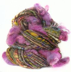This yarn is hand-spun from hand-carded BFL and merino wool, silk and sari silk.