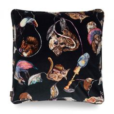 Luxury British velvet cushion featuring a carnival of animals print. Everyone has a favourite character in this at once breath taking and humorous pri...
