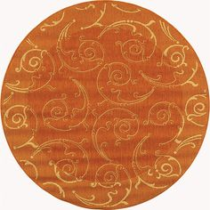 Update your home decor with a convenient indoor/ outdoor rug Rug features a transitional pattern in natural on a terracotta background Floor rug is crafted from a 100-percent fine-spun polypropylene pile