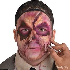 Step 5: Set your zombie makeup with powder to keep it all in place! Dribble black zombie blood around the wounds & below the eyes for the full effect!