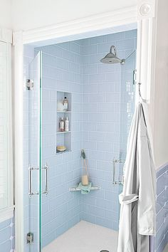 A recessed niche and a slim corner shelf hold necessities in this luxe shower. | Photo: Patricia Lyons | thisoldhouse.com