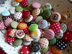 I finally figured out how to make fabric covered buttons and these are one's Id like to make.