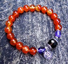 This elegant bracelet was made of high quality agate, amethyst, smoky quartz and silver plated OM