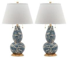 Swirls of blue and white give this pair of lamps painterly appeal while also adding welcome color to a room.