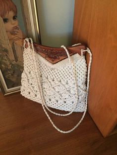 Charming vintage, boho day purse. Two narrow rope straps can go easily over the shoulder, or used as handles. It is in overall very good condition