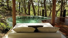 Forest pool with a couch.