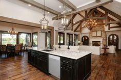 Spice It Up - Open Floor Plans We Love - Southernliving. One way to make an open floor plan dynamic is to vary the ceilings. The difference in the ceilings of the dining space, kitchen and living room that give each room their own unique feel. Built by Morning Star Builders of Houston, Texas.