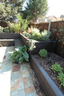 a backyard idea: raised bed/seat