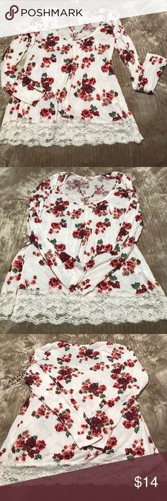 "Floral large top with lace. Bottom, lace on top Comfy, dress up or down. Size large, polyester, has a slightly wrinkled look. Flowers are rose, burgundy with green leaves. Wore a few times! Cute 26"" long , 19"" underarm, 21"" at hip Tops Tunics"