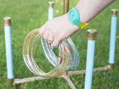 This super-simple backyard ring toss game can be easily assembled with supplies from your local hardware store. Plus, the shiny rings are sure to be a hit with the kids. Backyard Games Kids, Outdoor Games For Kids, Indoor Games, Indoor Activities, Summer Activities, How To Make Rings, Diy Rings For Ring Toss, Yard Party, Giant Games