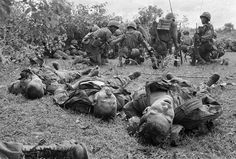 Vietnam: The Real War – Bodies of US paratroopers lie near a command post during the battle of An Ninh, 18 September 1965. The paratroopers, of the 1st Brigade, 101st Airborne Division, were hit by heavy fire from guerrillas that began as soon as the first elements of the unit landed. The dead and wounded were later evacuated to An Khe, where the 101st was based. The battle was one of the first of the war between major units of US forces and the Vietcong Photograph: Henri Huet/AP