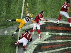Clay Matthews - Green Bay Packers v Atlanta Falcons.  I LOVE when his feet leave the ground  :)