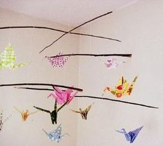 great idea for a baby shower is to have loved ones write wishes and sweet messages for the baby on the origami paper, and then fold the up the cranes and build the mobile. The mobile will carry with it all the positivity and sweetness of you and all your friends and family as it hangs out with your little one. by magdalena