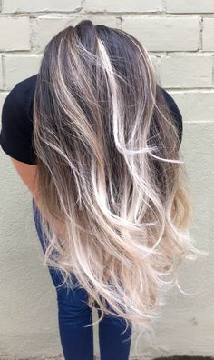 Dark to platinum blonde ombre. Switch it up this season and say goodbye to your dark locks and try something lighter! #hairenvy