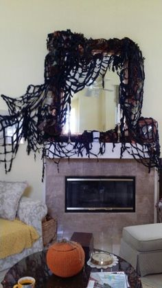 Cobwebs on my mantle for Halloween!