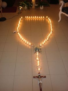 A candle rosary...kids will enjoy taking turns blowing the candles out after praying each Hail Mary!