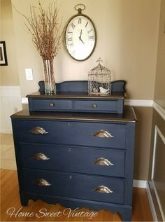 Vintage 1940's small dresser. Would be beautiful as an entry hall piece. Painted in Wise Owl bowie which is a deep navy blue and sealed in their clear hemp oil wax. The original wood carved drawer pulls and dresser tops are done in a pretty bronze metalic paint and sealed with poly.