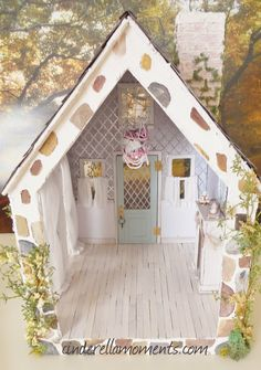 The Little White Cottage Dollhouse is done.       All the vines are from Hobby Lobby.                 When I started to put the moss on...