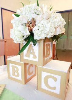 Baby blocks baby shower party centerpiece! See more party planning ideas at http://CatchMyParty.com!