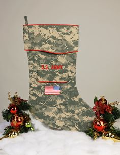 """The Army Christmas stocking is crafted in the ACU camouflage fabric. It's trimmed in scarlet piping and features the """"reverse American flag"""" embroidered on the stockings pocket. This Army ACU uniform Military Holidays, Military Mom, Military Girlfriend, Military Crafts, Christmas Activities, Christmas Crafts, Christmas Ornaments, Christmas Care Package, Bazaar Ideas"""