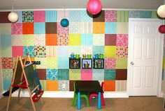 This whole playroom wall was covered in scrapbook paper! Perhaps a bit bold, but you get the idea.