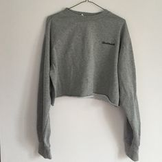 "Grey cropped sweatshirt Grey cropped crew neck sweatshirt from pacsun that looks just like the brandy Melville one. It's so soft and comfy on the outside and it says ""nevermind"" great condition also PacSun Sweaters Crew & Scoop Necks"