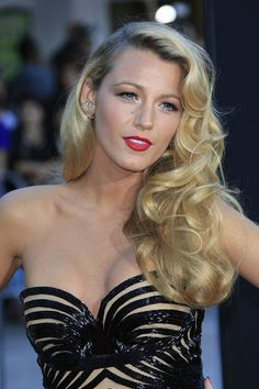 We can't get enough of Blake's old Hollywood look. For these big soft curls, use rollers or a large-barrel curling iron and brush through curls after letting them cool. Sweep to one side, and complete your look with a classic red lip.