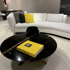 Curved white sofa, with a beautiful black marble table and bright yellow accents. Yellow Accents, Bright Yellow, White Sofas, Black Marble, Contemporary, Table, Furniture, Beautiful, Home Decor