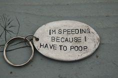 im speeding because i have to poop key ring. white elephant gift!