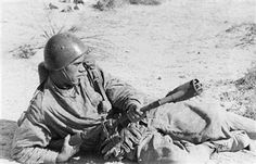 Italian sapper armed with a flame-thrower ready to get into action against the British close to Tobruk. Libya, September 1941 - pin by Paolo Marzioli