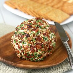 Bacon-Jalapeño Cheese Ball by traceysculinaryadventures: Cream cheese is mixed with cheddar cheese, bacon, jalapeños and flavored with herbs and spices, then shaped into a ball, which is rolled in more bacon, more jalapeños and toasted pecans. Colorful, fun, and perfect for a party since it can easily be made ahead of time. The jalapeños give it a little kick, but nothing too crazy. #Appetizer #Cheese_Ball #Jalapeño #Bacon