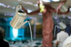 Most events that take on a garden theme use tons of flowers and foliage. But at a recent gala dinner and auction for the Georgiana Bruce Kirby Preparatory School in Santa Cruz, California, Peggy Young & Associates eschewed live plants and chose a different way to express the theme. In the dining room, galvanized watering cans hung over tables, with fiber optic lights mimicking water pouring out of the spouts.