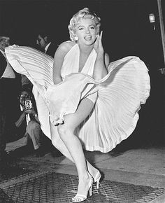 """A passing subway train below the street provides the lift for Marilyn Monroe's skirt as she stands on a grate in this 1954 photo. Monroe was in New York filming """"The Seven Year Itch."""" Ironically, this moment in the final movie was actually shot on a soundstage."""