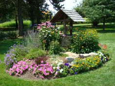 landscape wishing wells with flowers | of pleasure, however, go to the garden center to obtain your garden ...