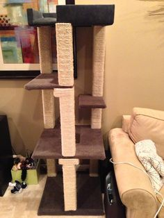 Homemade Cat Tower - Love all the scratching opportunities and running up stairs fun. #cats #CatTree