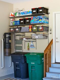 Put walls to work to clean up garage clutter. Take back unused space and suspend a shelving unit above recycling and garbage cans. Here, customized wire shelves hold overflow items, such as cleaning supplies. A stepladder nearby means nothing is ever out of reach.