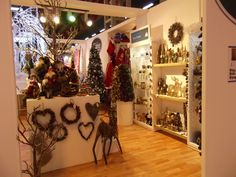 Rustic and traditional decorations: wooden wreaths, cheery Santas, and majestic reindeer.