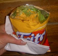 Walking Taco - This is not as much a recipe as it is a 'how to'.  Good camping food.  To save money:  Get some of the white deli containers (like Chinese take-out boxes - with the metal handles?) and buy the econo bag of chips (Fritos, Doritos, whatever) and make the walking taco in the disposable deli container.  Make plenty of the taco meat mix and bring plenty of prepared  toppings.  This is a very popular camp food that is easy to fix, easy to eat, delicious, and easy to clean up after.