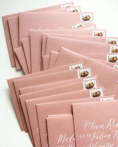 Gorgeous dusty rose envelopes with white calligraphy. Postage from USPS. White Calligraphy | Calligraphy Envelopes | Envelope Inspiration | Wedding Invitations | Custom Wedding Invites | Beautiful Envelopes | Envelope Addressing | Envelope Calligraphy | Modern Calligraphy