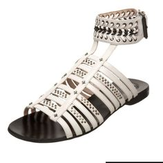 Modern vintage Andy leather ivory sandals Sz 7.5 Modern vintage Andy leather ivory sandals Sz 7.5 new These strappy flat leather sandals feature assorted studs. Chain inset at buckled ankle strap. Rubber sole Modern vintage Shoes Sandals