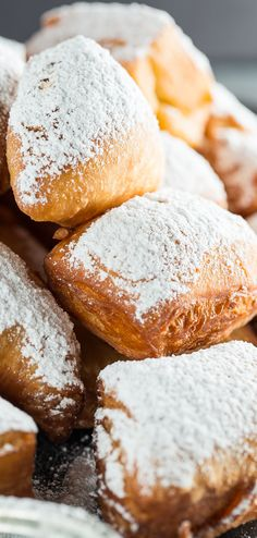 Homemade Beignets - fried pieces of dough covered in lots of powdered sugar.