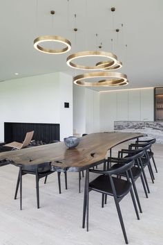 Gallery of Residence VDB / Govaert & Vanhoutte Architects - 45. We love the simplicity of the pale wooden floor which is a great backdrop for the funky lights and beautiful wooden table.