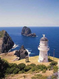 Cape Brett Lighthouse, Bay of Islands, New Zealand. The site was surveyed and chosen in 1908 by Captain John Bollons of NZGSS Hinemoa. The lighthouse was deactivated and keepers withdrawn in 1978 and replaced by an automated beacon on the same site. The Places Youll Go, Places To Visit, Bay Of Islands, Beacon Of Light, New Zealand, Beautiful Places, Scenery, Around The Worlds, Lighthouses