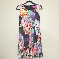 "Betsey Johnson Multicolored Floral Dress New with tags, never worn, vibrant Betsey Johnson multicolored floral dress! Sleeveless, scoop neckline and zipper closure in back. Lining (polyester) and dress (polyester/spandex). Size 4 should fit: Bust = 38""; Waist = 32"" and Low Hip = 42"". Offers welcomed! Betsey Johnson Dresses Midi"
