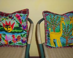 2 Authentic and Elegant Multicolored Guatemalan Pillow Covers with a beautiful multicolored Huipil Guatemalan Fauna and Flora scene, with a White background. Measurements: Width: 17.5 inches Height: 18 inches Depth: 4 to 6 inches  The first time they are washed hot water and salt is recommended to prevent decoloring. For subsequent washes, dry cleaning is recommended.  For returned items, shipping must be paid by customer. After receiving a returned product a full refund is offered if the…