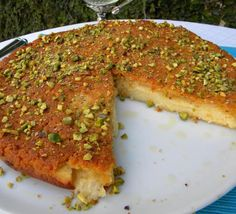 Knafeh....A flat platter usually made with semolina dough and a filling of melted gooey cheese or clotted cream | Hadia's Lebanese Cuisine