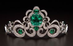 The famous emerald and diamond Moreira tiara featuring one of the largest jewelry quality emeralds ever found.  Platinum tiara with (42.4 carats) large center emerald, (7.56 carats) side emeralds a…