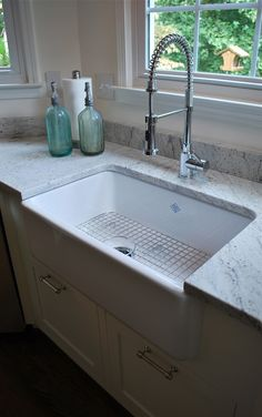 "If you are using an under-mount farmhouse sink you might want to consider using a solid 1.25"" counter top material rather than a built up 1.5"" counter top (the standard in California). Ask your kitchen designer or counter top installer about this detail."